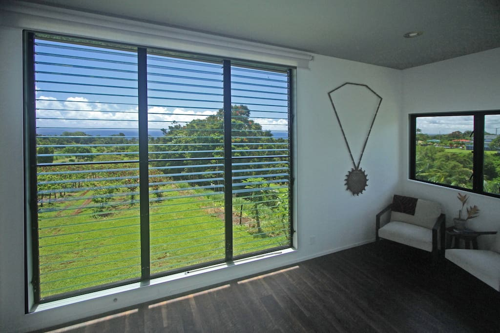 Enjoy the giant bedroom window overlooking ocean and cacao orchard.