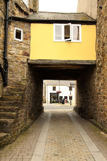 Leading to courtyard parking