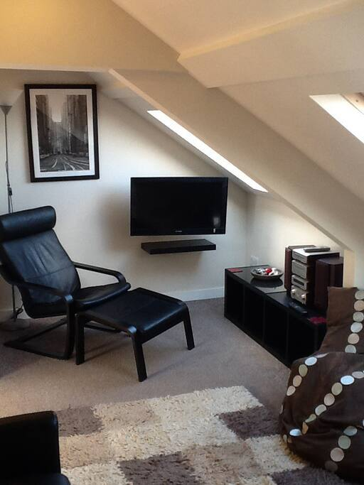 Lounge area with TV and Hi Fi