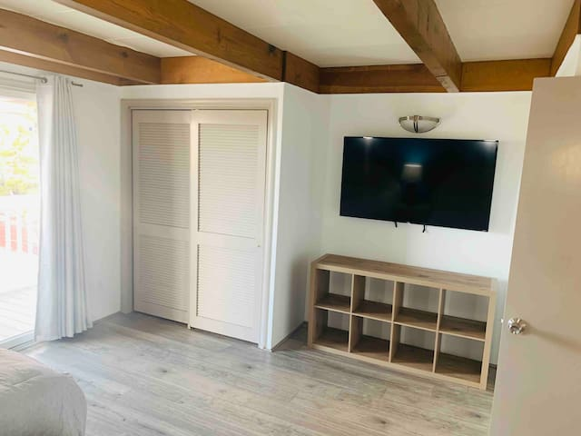 Huge TV in MBR with plenty of storage in closet and cubbies for personal items