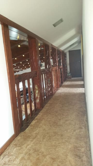 Top floor hall way looks down into 'Rec' room