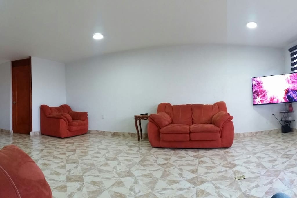 "Comfortable  living room with 55"" 4k Tv. Netflix, HBO,CNN, Youtube..."
