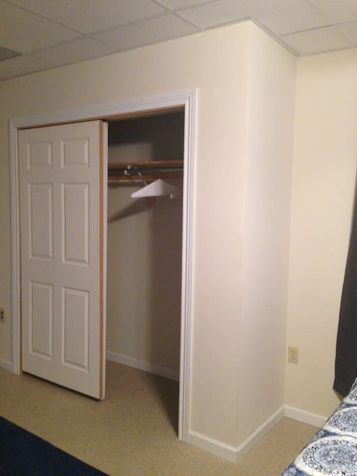6 ft Walk in Closet, with overhead storage space.  Hangers included.