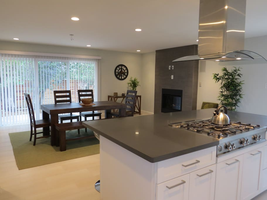 Kitchen with 4 barstools and dining area