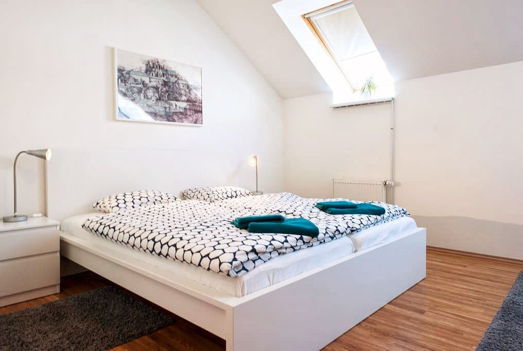 Blue room - double bed, 2 roof windows, 2 comfortable chairs and a closet.