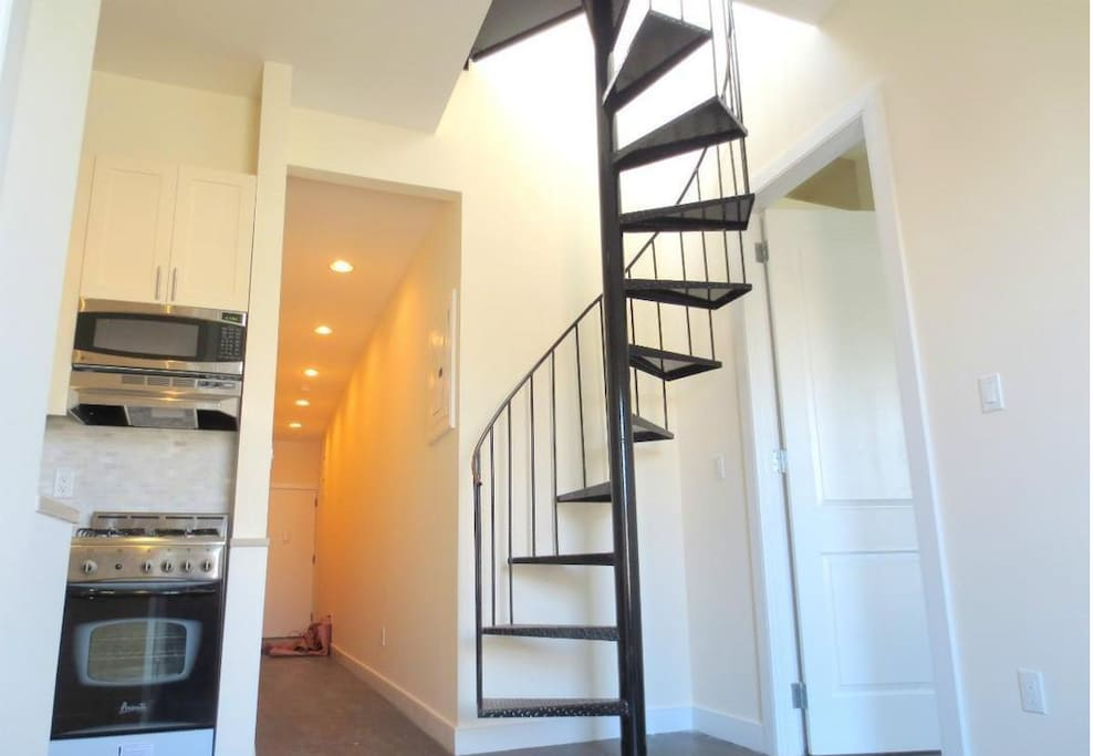 In-suite access to roof deck from spiral staircase