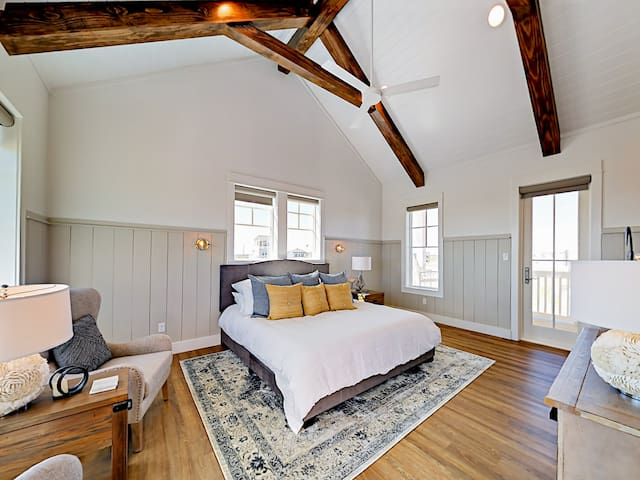 Watch TV on the flat-screen in the master bedroom. There's also an inviting sitting area for reading.