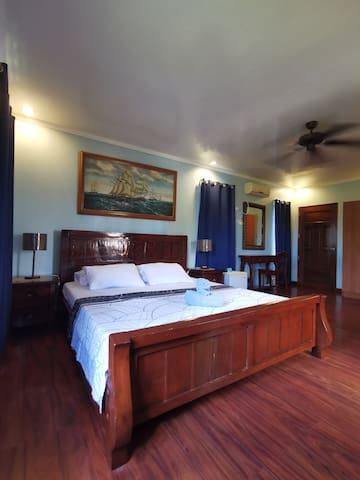 ROOM B. Located at the 2nd flr. Super King Sized bed.  With own Toilet & Bathroom and Balcony.   With 1 extra double sized mattress. (for guests more than 10 people)
