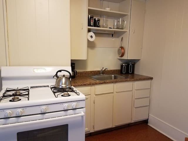 Pots & pans, dishes, utensils, coffee maker, teas,coffee, . sugar,and creamer is provided