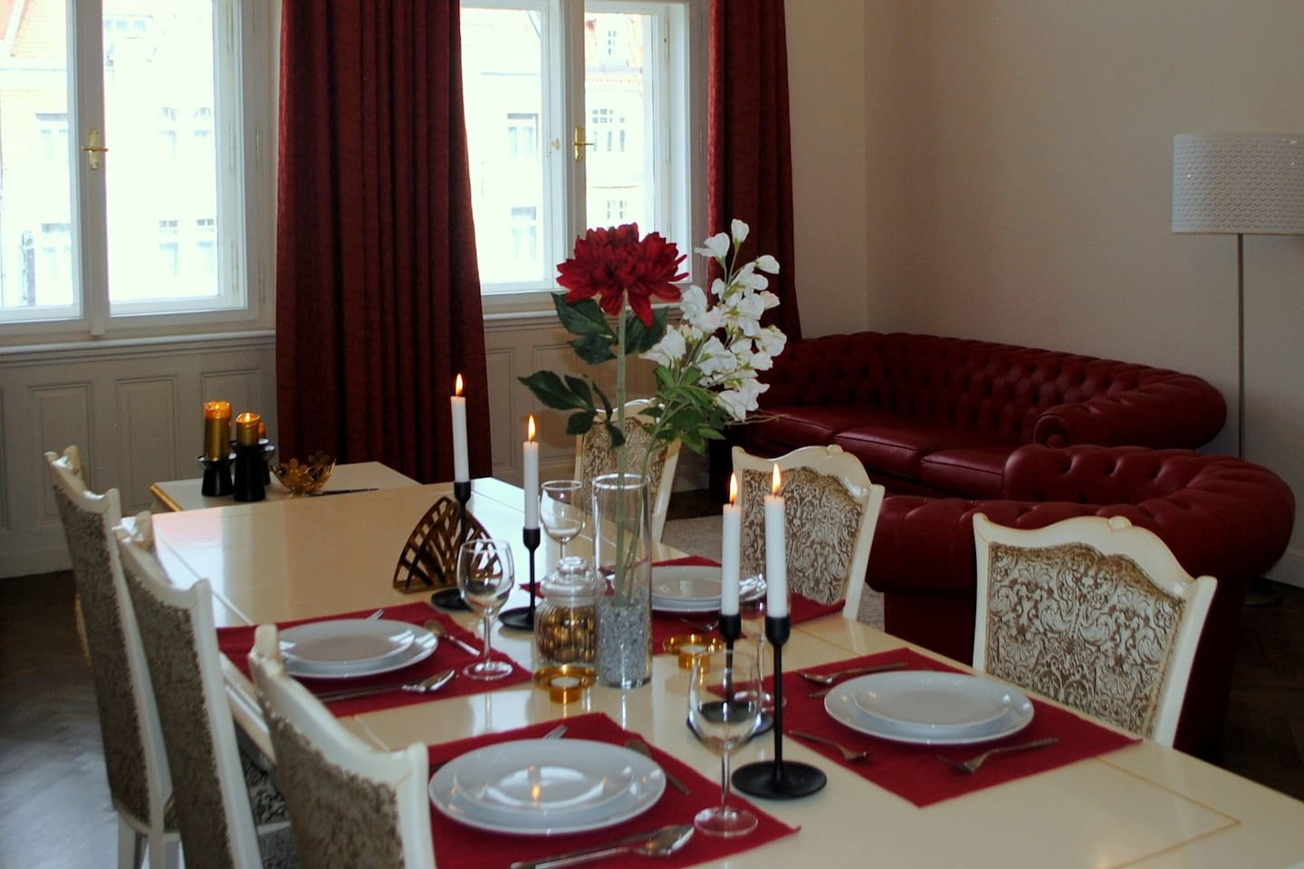 Living room with large dining table for 6, seating corner. All amenities required for a stylish dining or socializing setup are available