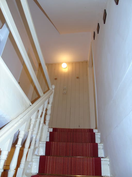 Inner staircase to the top floor of the house-apartment