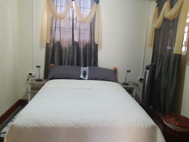 One queen sized bed,in bedroom with natural lighting and you can hear the tumbling waves on sand ,its an ensuite room.