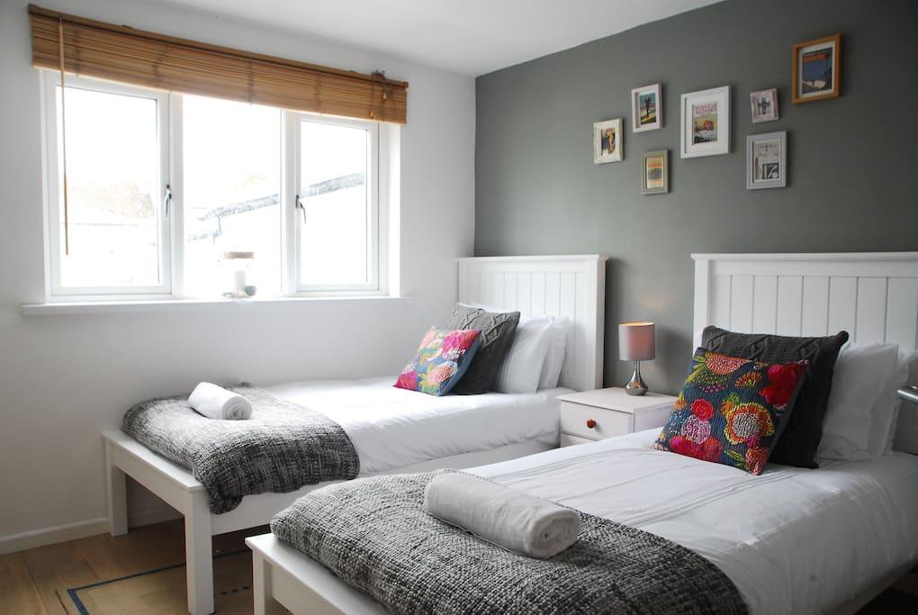 Stylish twin bedroom with memory foam mattresses.