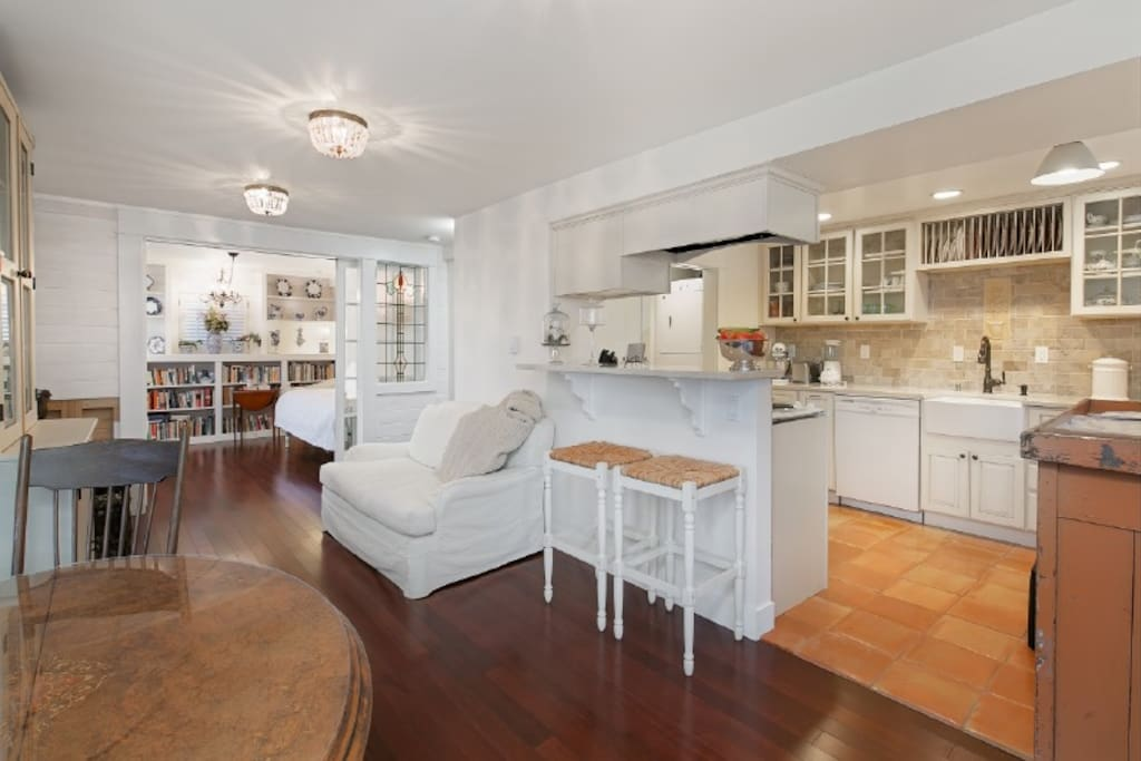 The living room and kitchen with the French doors open