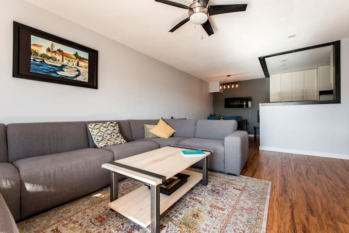 Fraser St newly renovated, bright and cheery condo