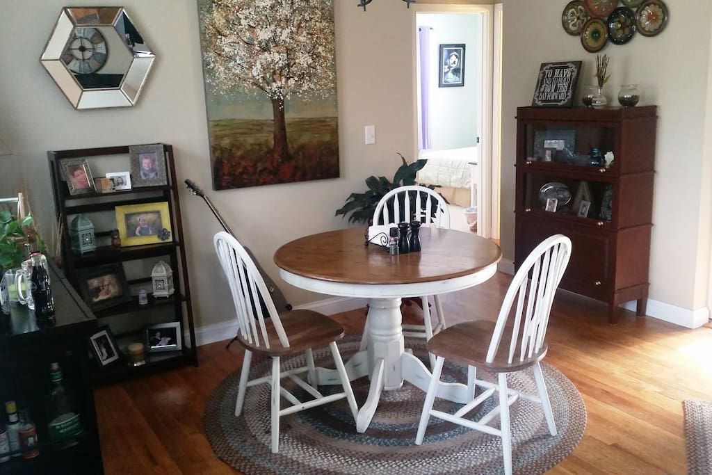 Dining area across from living room setup