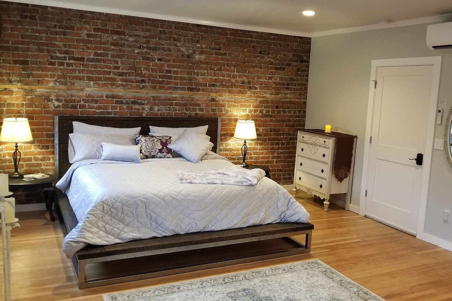 This beautiful space underwent a major remodel, completed in late December of 2018.  It features refinished Fir wood floors throughout, new king size 3 layer foam bed with organic bamboo sheets. Ultra quiet ductless heat and air conditioning system that you have full control of. The kitchen too has been transformed with new cabinets topped with Fir slab countertops and a gas stove.  The bathroom has been updated with new fixtures aside from the clawfoot tub being the one remaining touch of old. Fitted with a sliding shower head and curtain or you can soak with a book if you prefer.  This room has 3 good size windows overlooking the street below.