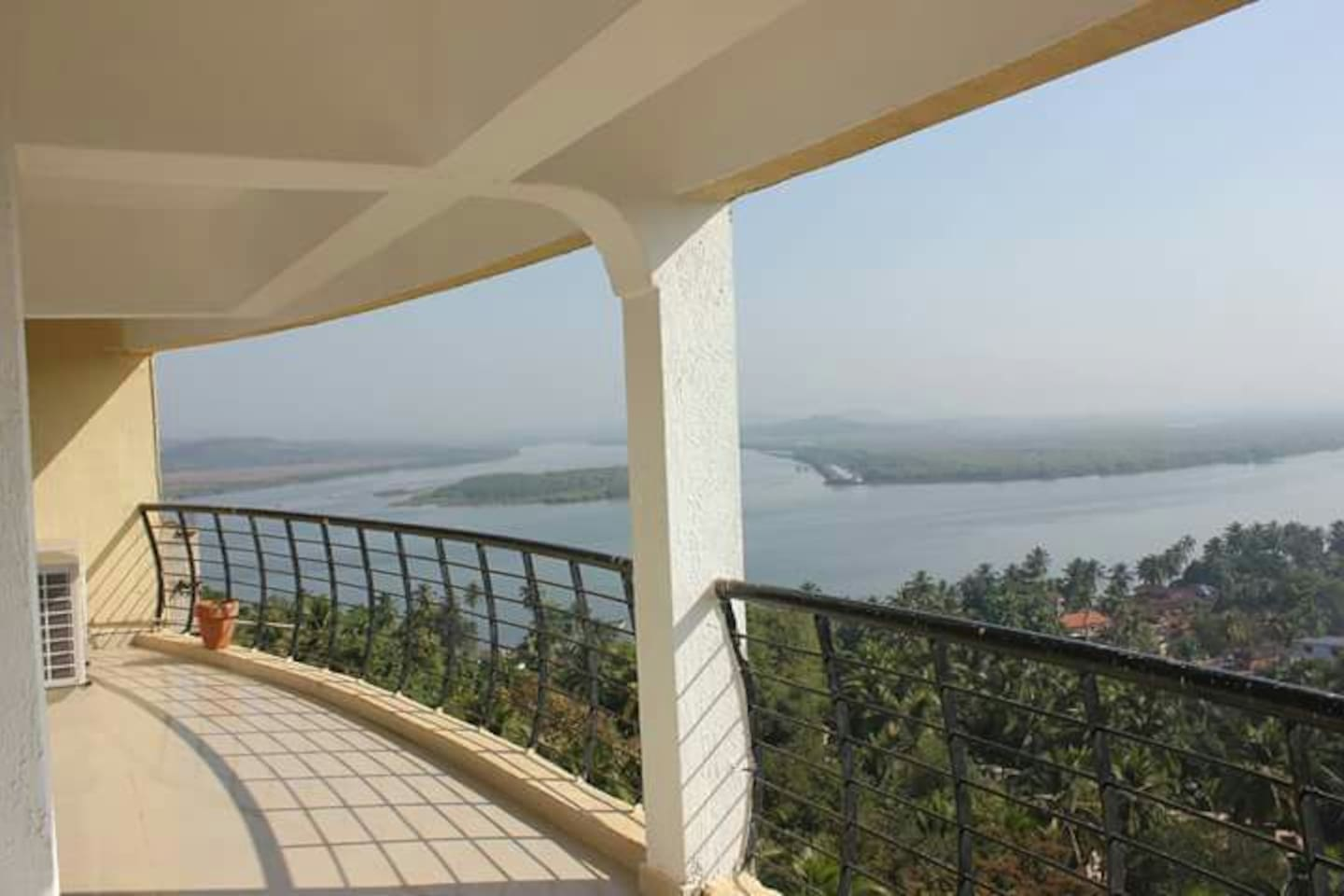 Wide balcony with Unobstructed view of Mandovi review and Divar Island.