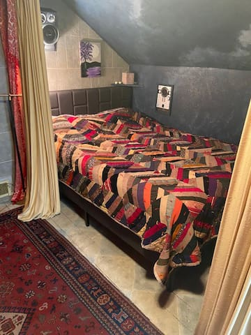Landing room full size bed. Has a curtain that can pull to close for privacy.
