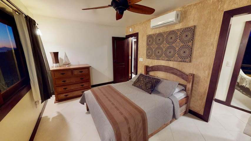Our lovely Second Suite includes  Double size bed  Dresser for storing all your belongings  French doors that lead to balcony  En suite complete bathroom  Air conditioner & ceiling fan  Two private balconies