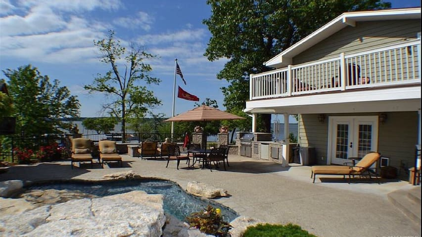 Private Balcony with lake and pool view - cool pool deck with lots of seating options