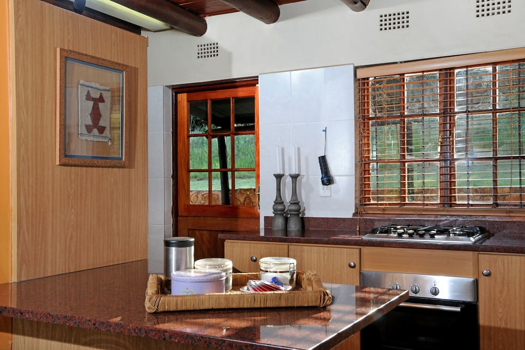 Well-equipped open plan kitchen with dishwasher