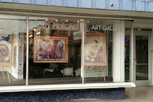 Tatoo shop, piercings and art gallery all in one.  Walking distance.