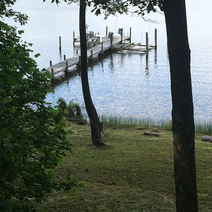 View from house. Dock with boat slip.