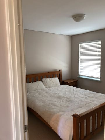 Large spacious bedroom with queen bed wardrobe and ensuite