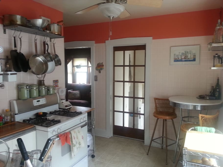 Full kitchen that has a coffee maker, microwave, and other essential amenities.