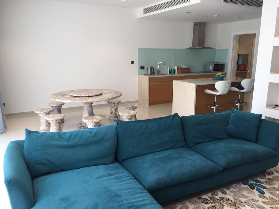 Spacious contemporary lounge and dining area. Feature marble dining table seats 8 for fun, family times together.