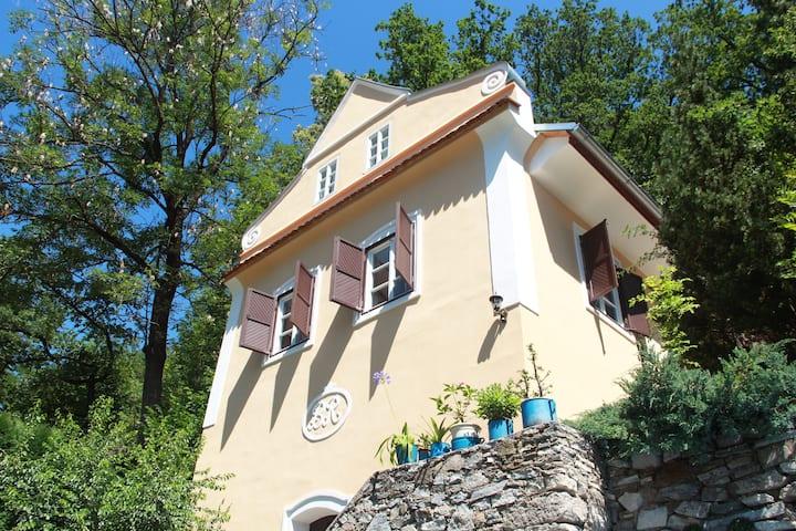 Krumlovský dům v zahradě