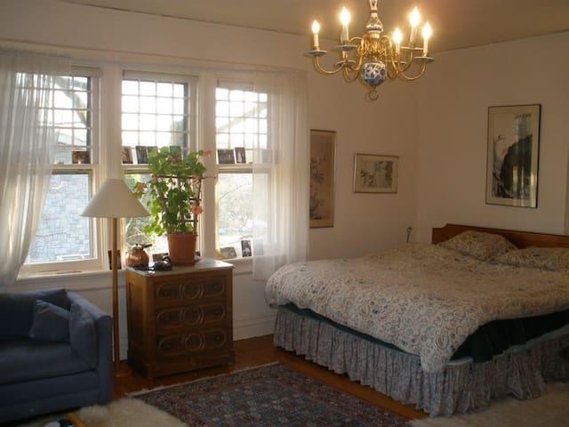 Master bedroom; king bed; windows overlooking Sound