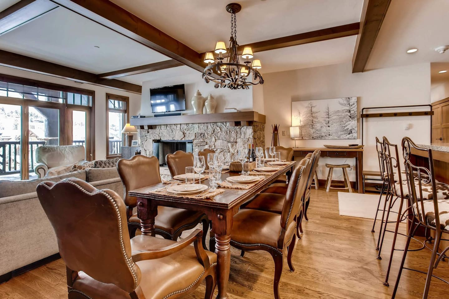 Between the elegant wood and leather chairs, grand dining table, and overhead chandelier, you can have a 5-star restaurant experience in your own home.