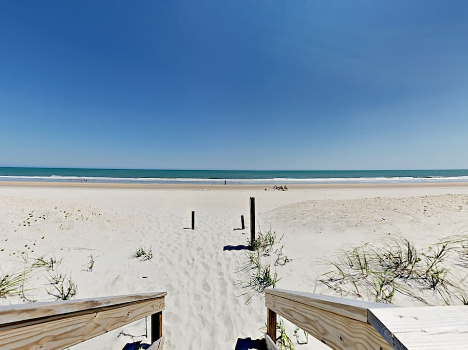 Enjoy a fun-filled day in the sun at the beach, just a short walk from your rental.