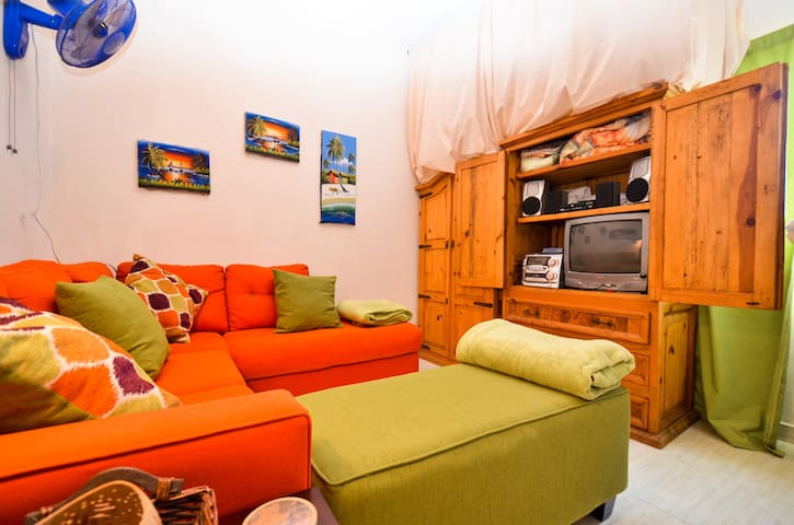 Your private living room with cable, a stereo, DVD, 3rd guest sleeping area, cot or sectional.