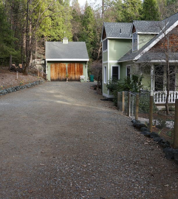 The driveway with plenty of parking.  Guest cottage is above garage, separate from the house.