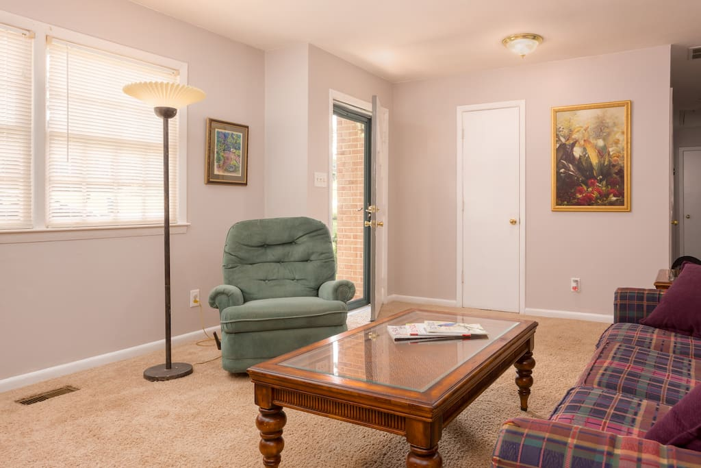 Relax and unwind in the living room. Check out the desk area, perfect for business travelers!
