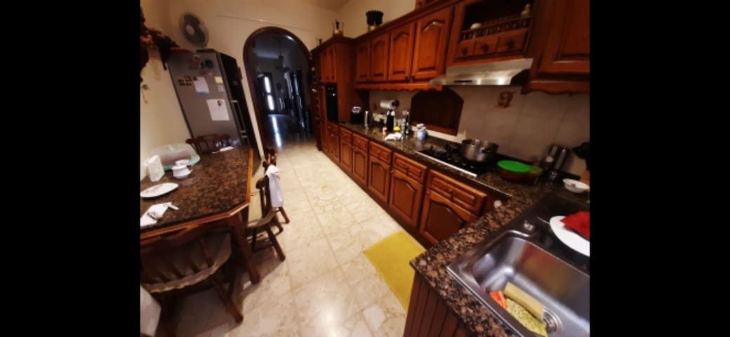 Kitchen Dining area. Where you will be having your included breakfast and local family food dinner.