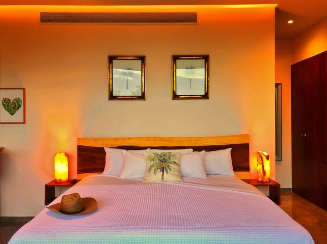 A very confortable king size bed with fresh linen, beautiful lighting and a large 55 inch smart TV