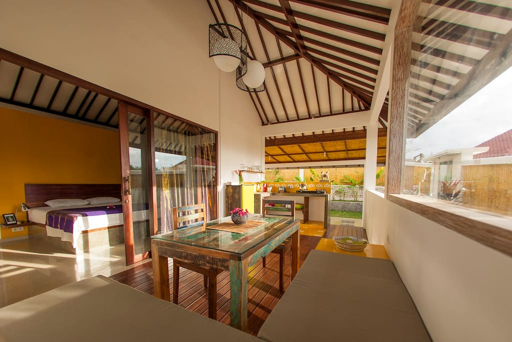 dining area with the open air kitchen