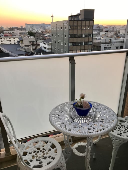 View from the balcony of the room: beautiful Kyoto Tower  with sunset.