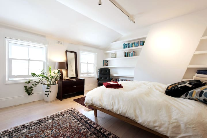 Your spacious room - quiet and homey with a leafy outlook over neighborhood street