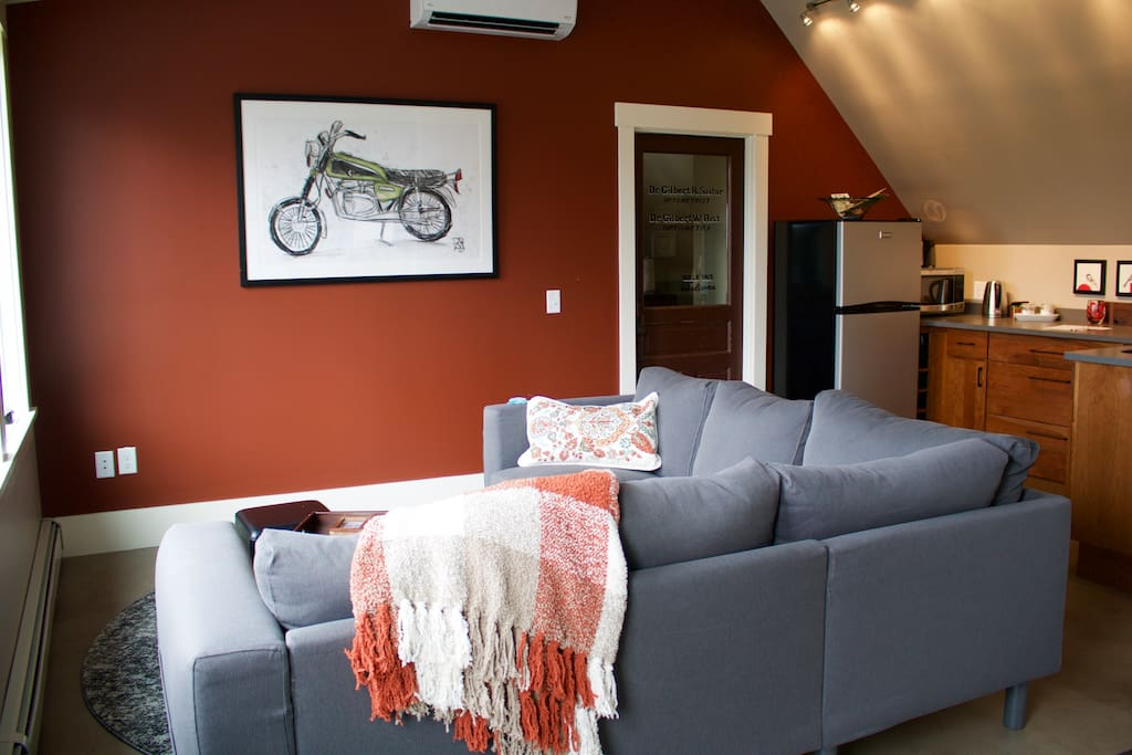 Living and dining area Super comfy couch. Lucky Bed   Breakfast  Perfect Downtown Location    Apartments for