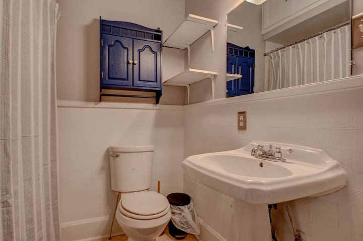 Bathroom has a shower/bathtub combo, a mirror, and a convenient outlet.  Shelves are also available to store your toiletries and/or make-up.  Plus towels are provided.