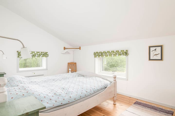 Light and airy bedroom with a comfortable double bed.