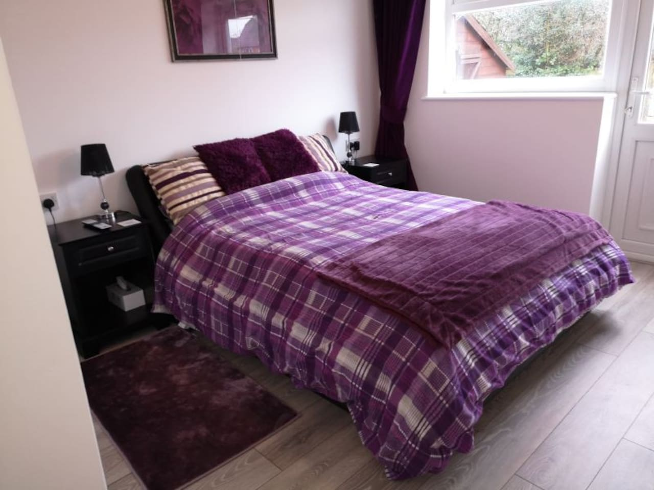 Comfortable double bed with full length black out curtains.
