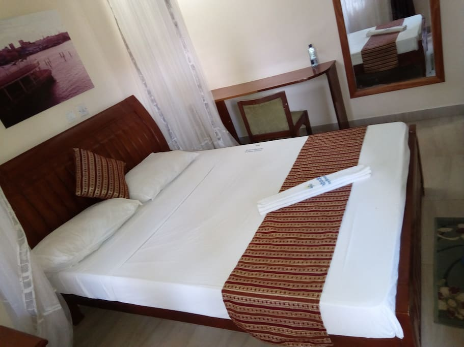 Double room. Spacious, TV,fan,hot shower,closet,balcony, working table,mosquito net, access card