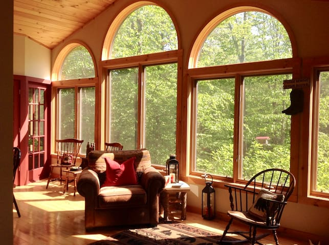 Sunroom opens to the kitchen as well as out to an indoor/outdoor gas grill - convenient in any weather!
