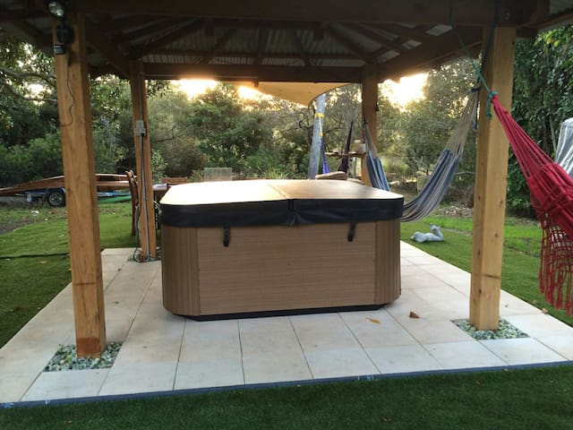 Enjoy the sunset over the river while taking a nice soak in the hot tub! We do!